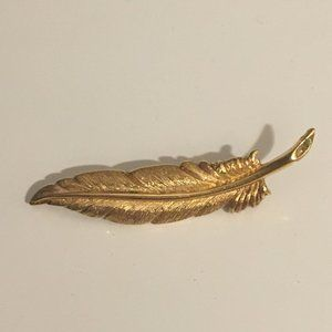 Vintage Monet gold tone feather brooch
